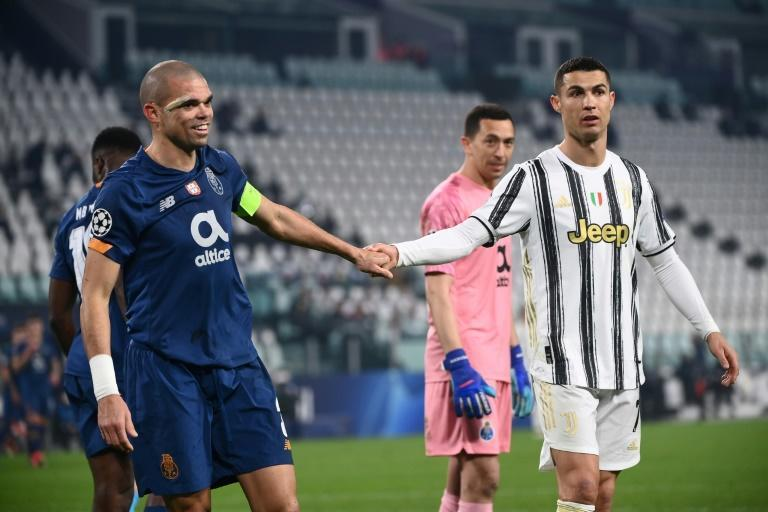 Ronaldo's (R) fellow Portuguese international Pepe (L) pulled off heroics for 10-man Porto.
