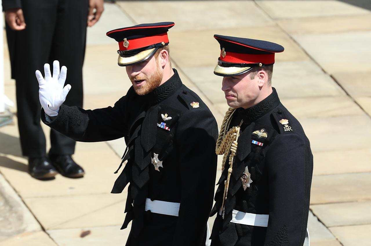 <p>A nervous-looking Harry waved to crowds with his brother William by his side before entering the chapel. Photo: Getty </p>
