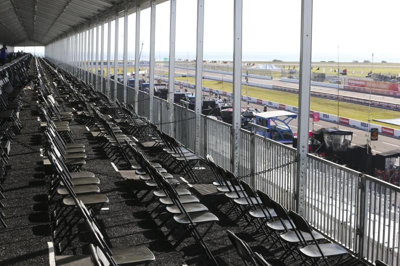 The spectator VIP area overlooking pit lane is virtually empty at the IndyCar Grand Prix of St. Petersburg, Friday, March 13, 2020 in St. Petersburg. NASCAR and IndyCar have postponed their weekend schedules at Atlanta Motor Speedway and St. Petersburg, due to concerns over the COVID-19 pandemic. (Dirk Shadd/Tampa Bay Times via AP)