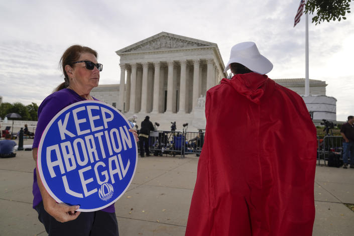The Supreme Court is seen on the first day of the new term as activists demonstrate on the plaza, in Washington, Monday, Oct. 4, 2021. Arguments are planned for December challenging Roe v. Wade and Planned Parenthood v. Casey, the Supreme Court's major decisions over the last half-century that guarantee a woman's right to an abortion nationwide. (AP Photo/J. Scott Applewhite)