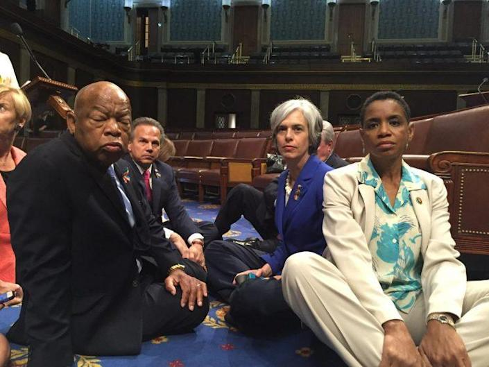 Reps. John Lewis (left), David Cicilline (center-left), and Donna Edwards (right) conduct a sit-in with other Democrats on the House floor on June 22, 2016. (Photo: Rep. Donna Edwards/Twitter)