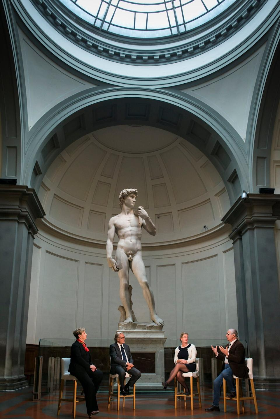 Staff members from the University of Florence discuss the process of digitally recreating Michelangelo's iconic