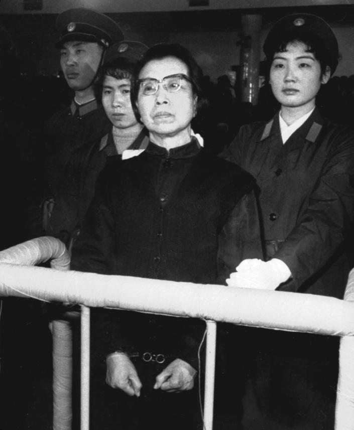 FILE - In this January, 1981 file photo released by China's Xinhua News Agency, Jiang Qing, the widow of Chinese leader Mao Zedong, stands handcuffed in the Supreme People's Court in Beijing, China during the Gang of Four Trial. Mao's wife, Jiang Qing, lead a series of purges that, after Mao's death in 1976, resulted in her being sentenced to death for counterrevolutionary crimes. Though some see Jiang as a cautionary tale against the ruthlessness of power-hungry females, she claimed she was only following orders. (AP Photo/Xinhua, File) NO SALES