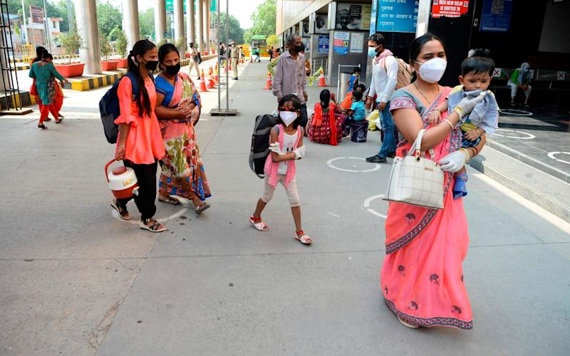 Passengers arrive at New Delhi railway station as lockdown travel restrictions are eased - Sajjad Hussain/AFP