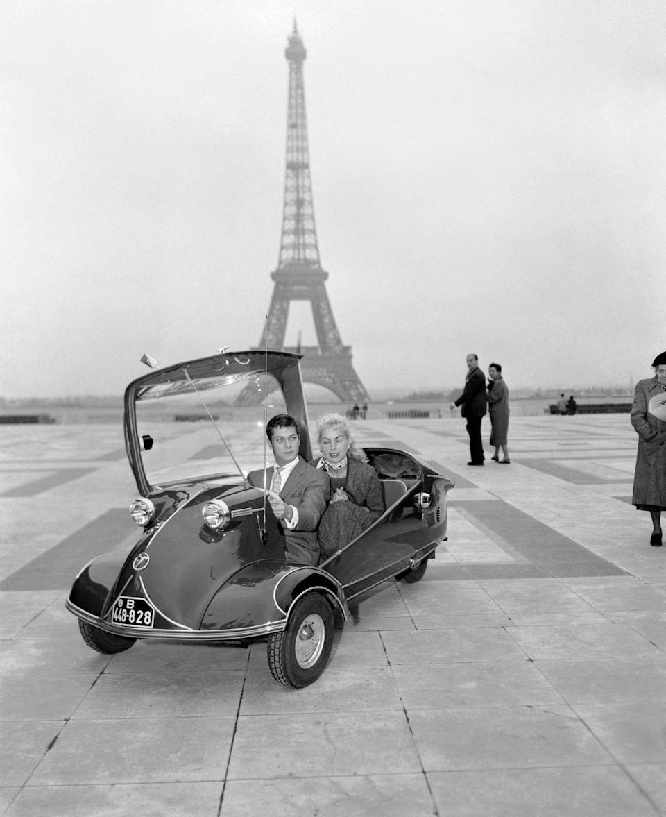 <p>Tony Curtis and then-wife Janet Leigh go for a spin in a Messerschmitt two-seater. She was in town visiting him while he filmed <em>Trapeze</em>.</p>