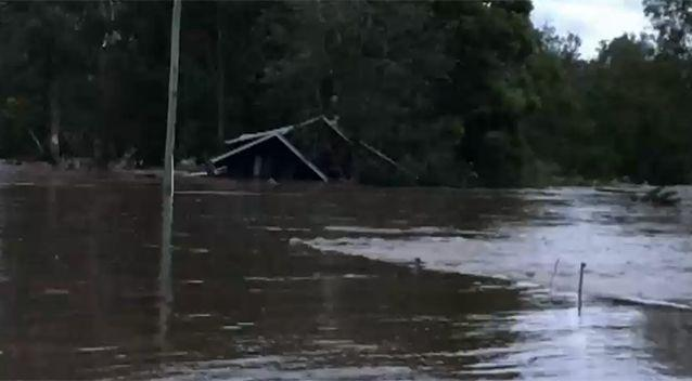 The house travelled down the flooded Albert River. Source: ABC