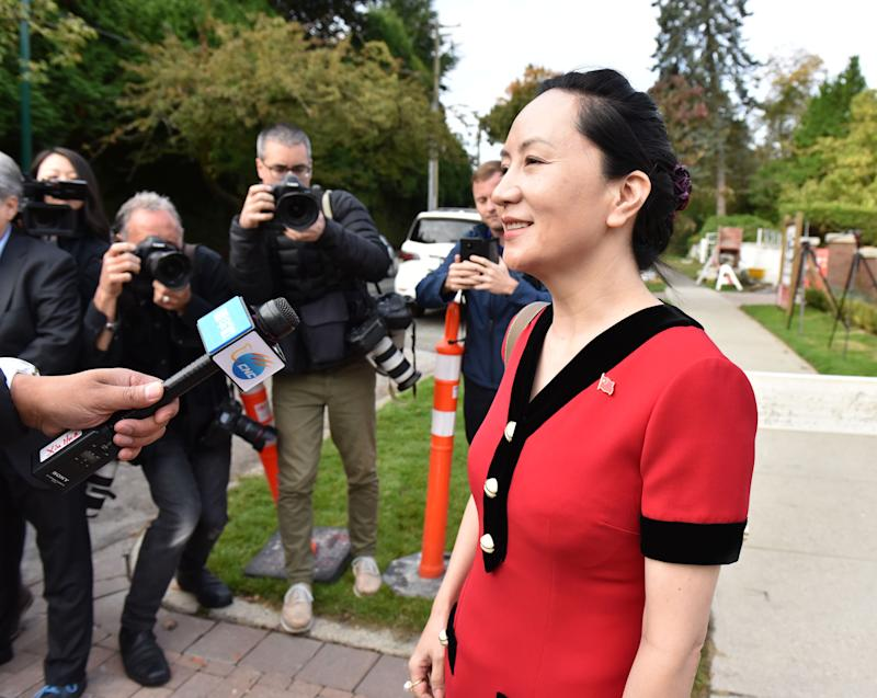 Huawei Chief Financial Officer, Meng Wanzhou, stops to talk to media while leaving her Vancouver home to appear in British Columbia Supreme Court, in Vancouver, on October 1, 2019. - The 47-year-old Huawei chief financial officer was detained during a stopover at the Vancouver airport in December 2018, on a US warrant. The US wants to put Meng on trial for fraud for allegedly violating Iran sanctions and lying about it to US banks -- accusations her lawyers dispute. Meng -- a rising star whose father Ren Zhengfei founded Huawei and over three decades grew it into a global telecom giant -- expressed surprise when told she was being arrested, according to a transcript of her speaking with authorities after her flight from Hong Kong landed. (Photo by Don MacKinnon / AFP) (Photo credit should read DON MACKINNON/AFP via Getty Images)