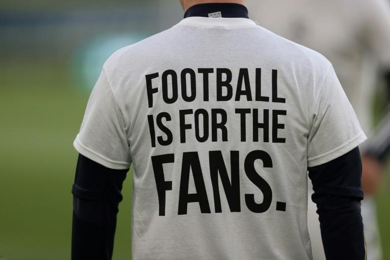 """Leeds United's players wore t-shirts saying """"Football is for the fans"""" ahead of Monday's Premier League clash with Liverpool"""