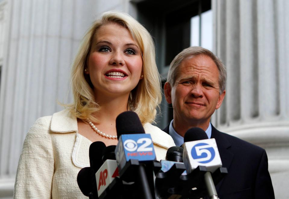 Elizabeth Smart and her father Ed Smart talk to the media in front of the Frank E. Moss Federal Courthouse Wednesday, May 25, 2011, in Salt Lake City.