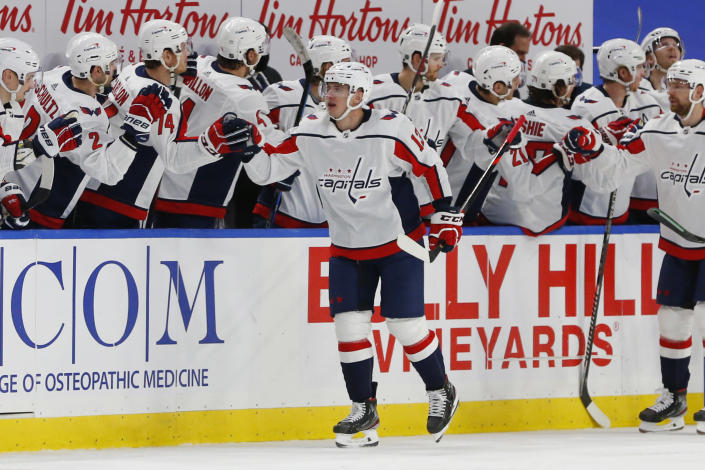 Washington Capitals' Jakub Vrana (13) is congratulated for his goal during the second period of the team's NHL hockey game against the Buffalo Sabres, Friday, Jan. 15, 2021, in Buffalo, N.Y. (AP Photo/Jeffrey T. Barnes)