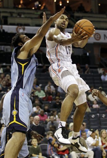Charlotte Bobcats' Gerald Henderson, right, drives past Memphis Grizzlies' Hamed Haddadi, of Iran, during the first half of an NBA basketball game in Charlotte, N.C., Friday, April 20, 2012. (AP Photo/Chuck Burton)