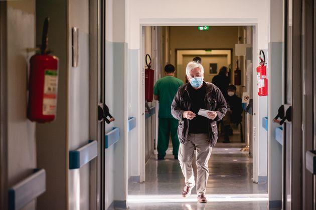 MILAN, LOMBARDIA, ITALY - 2021/02/25: A old man seen walking in the corridors at the health facility. Covid-19 vaccination campaign for people over eighty years is going on at the new hub for Defense anti-Covid-19 vaccines, set up at the Military Hospital Centre in Baggio district. More than ten thousand vaccination have already been distributed, giving Pfizer/BioNTech to those aged more than eighty and AstraZeneca to non hospital health personnel. (Photo by Valeria Ferraro/SOPA Images/LightRocket via Getty Images) (Photo: SOPA Images via Getty Images)