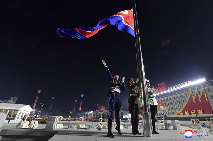 """In this photo provided by the North Korean government a North Korean flag is hoisted in the celebration for the ruling party congress, at Kim Il Sung Square in Pyongyang, North Korea Thursday, Jan. 14, 2021. Independent journalists were not given access to cover the event depicted in this image distributed by the North Korean government. The content of this image is as provided and cannot be independently verified. Korean language watermark on image as provided by source reads: """"KCNA"""" which is the abbreviation for Korean Central News Agency. (Korean Central News Agency/Korea News Service via AP)"""