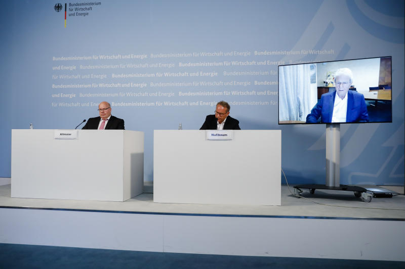 German Economy Minister Peter Altmaier (L), and state secretary at the economic ministry Ulrich Nussbaum (R) attend a news conference with with CureVac main shareholder Dietmar Hopp (on the screen right) at the economy ministry in Berlin on June 15, 2020. - The German government is taking a 23 percent stake in the German company CureVac working on a potential vaccine for the novel coronavirus. (Photo by Markus Schreiber / POOL / AFP) (Photo by MARKUS SCHREIBER/POOL/AFP via Getty Images)