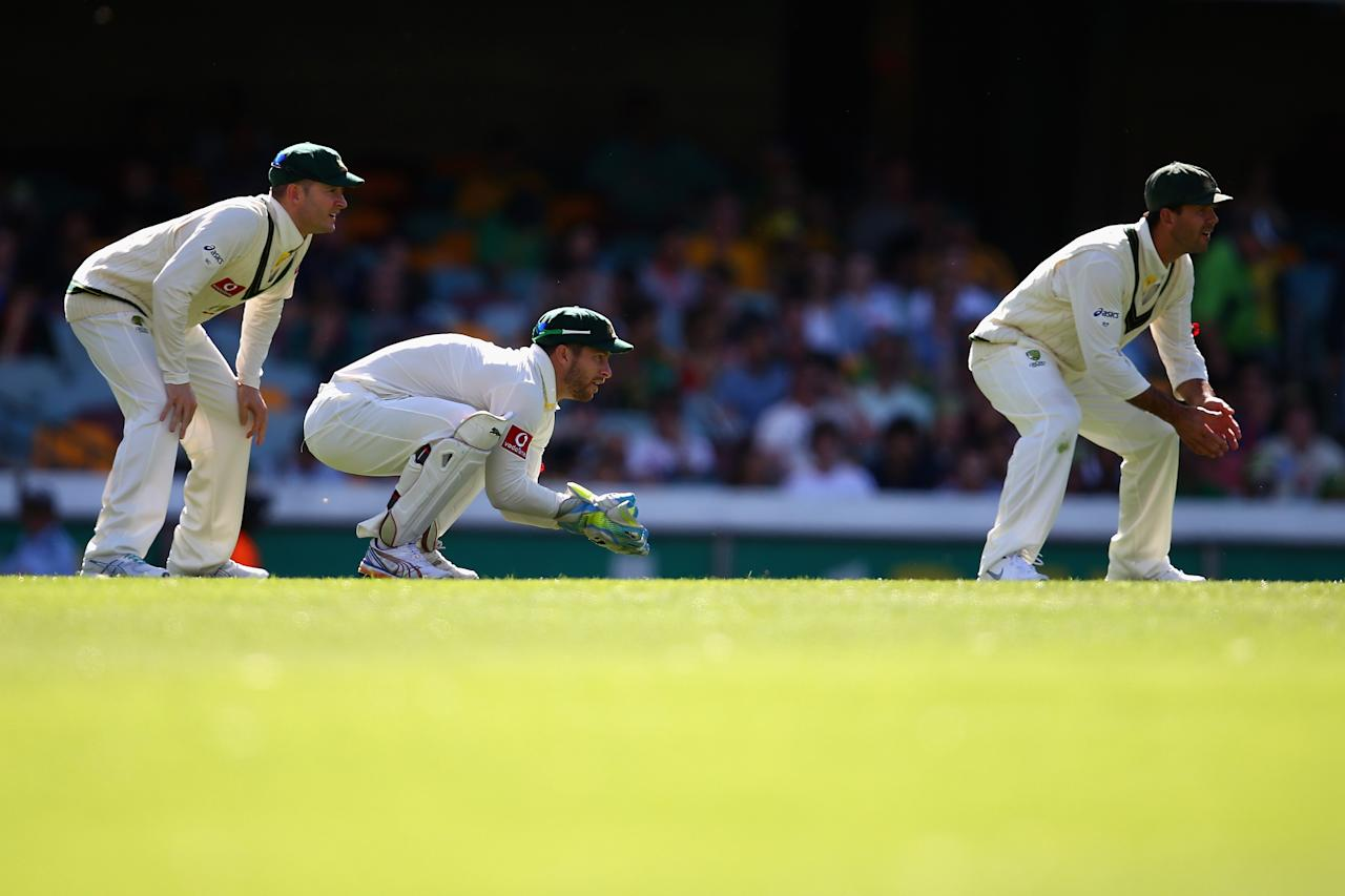 BRISBANE, AUSTRALIA - NOVEMBER 11: Michael Clarke, Matthew Wade and Ricky Ponting of Australia  field during day three of the First Test match between Australia and South Africa at The Gabba on November 11, 2012 in Brisbane, Australia.  (Photo by Ryan Pierse/Getty Images)