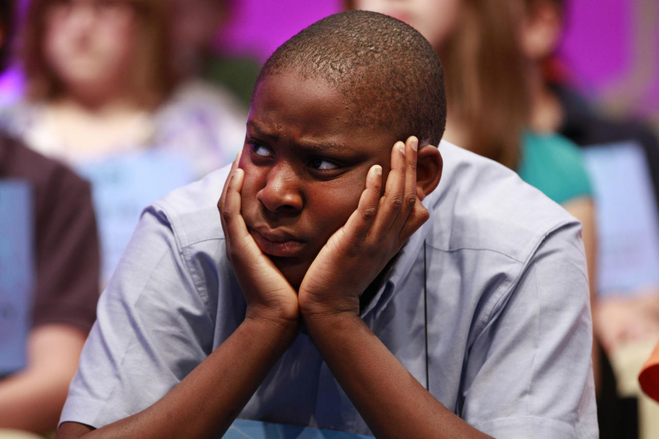 Eboseremhen Eigbe, 12, of Galloway, N.J, watches a speller struggle to spell a word during the third round of the National Spelling Bee in Oxon Hill, Md., on Wednesday, May 30, 2012.  (AP Photo/Jacquelyn Martin)