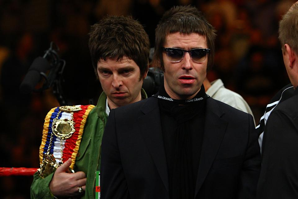 Noel and Liam Gallagher of Oasis bring out boxer Ricky Hatton of England's belts before taking on Paulie Malignaggi during their light-welterweight fight at the MGM Grand Garden Arena November 22, 2008 in Las Vegas, Nevada.  (Photo by John Gichigi/Getty Images)