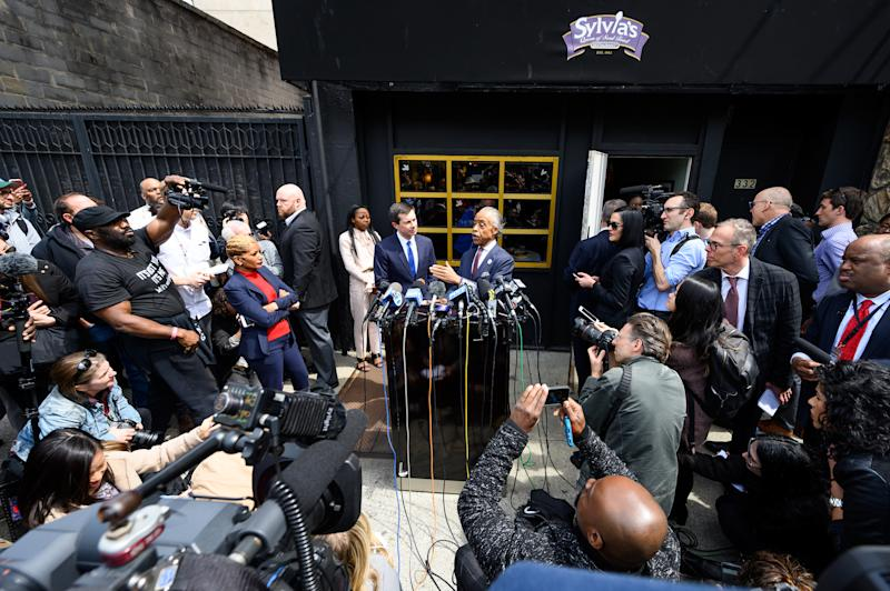 NEW YORK, NY, UNITED STATES - 2019/04/29: Mayor Pete Buttigieg (D) of South Bend, Indiana and Rev. Al Sharpton seen speaking during a press conference at Sylvia's Restaurant in Harlem, New York City. (Photo by Michael Brochstein/SOPA Images/LightRocket via Getty Images)