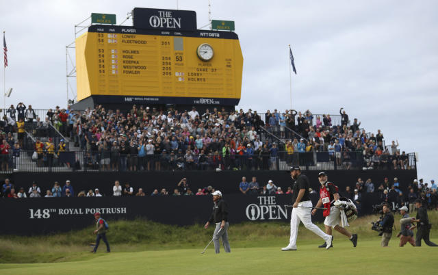Ireland's Shane Lowry walks onto the 18th green during the third round of the British Open Golf Championships at Royal Portrush in Northern Ireland, Saturday, July 20, 2019.(AP Photo/Peter Morrison)