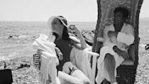 <p>Audrey Hepburn soaks up the sun while Albert Finney relaxes in the shade during the filming of <em>Two for the Road</em> in 1966.</p>