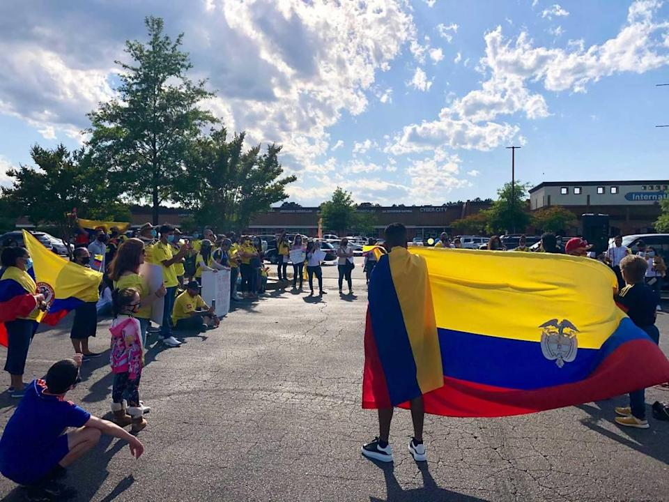 Around a hundred Colombians and other supporters gathered at Villa Latina plaza on Chapanoke Road in Raleigh on Saturday, May 8, 2021 in support of anti-government protests that have swept the South American country.