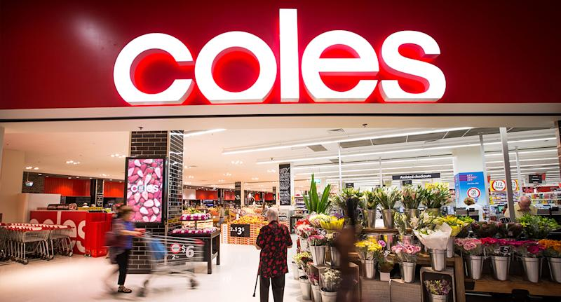 Picture of a Coles storefront - the supermarket is having security during Best Buys promotion.