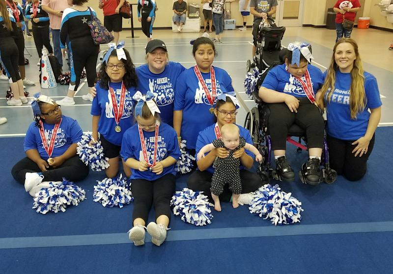 Allee Pence and Elaine Schor pose with Team Mesquite Cheer at the Special Olympics Texas Cheerleading Championships. (Credit: Allee Pence/Elaine Schor)