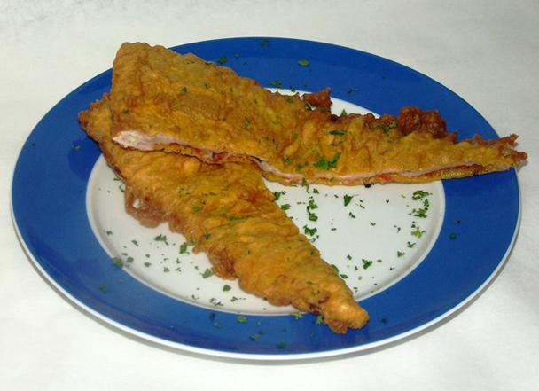 """<div class=""""caption-credit""""> Photo by: Gourmet.com</div><b>Deep-Fried Pizza Pie</b> <br> <br> Deep-fried pizza may be a Scottish specialty, but we're giving a shout-out to Brooklyn's ChipShop for bringing batter to the celebrated New York slice. Owner Chris Sell starts off with pizzas from a nearby shop that he refrigerates before dipping slices in a classic fish-and-chips batter of flour, malt vinegar, baking powder, water, and salt. A quick fry in bubbling hot oil yields a tantalizing triangle that's crispy on the outside and cheesy on the inside."""