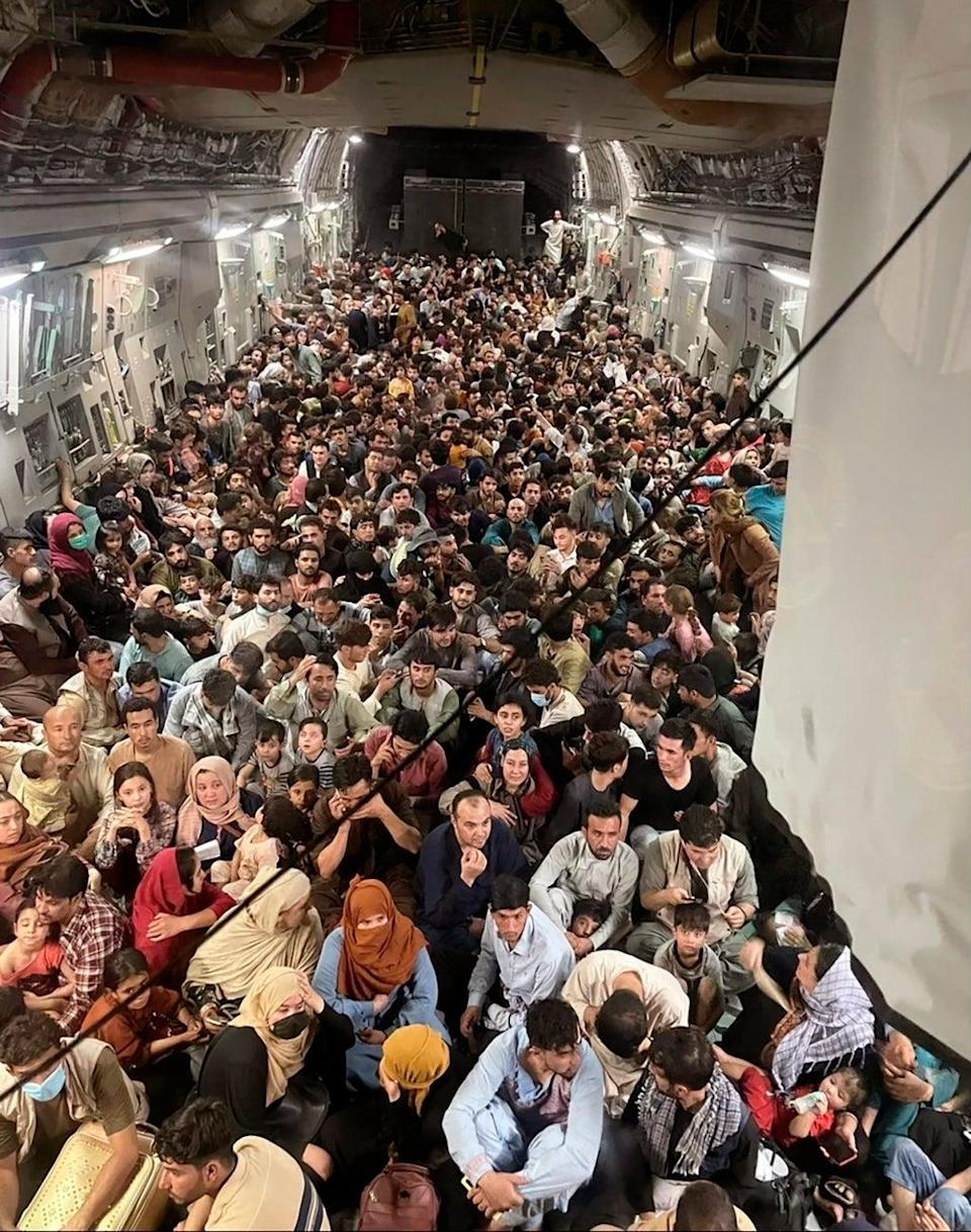 Afghan citizens pack inside a US Air Force plane as they were transported from Hamid Karzai International Airport on Sunday (Capt. Chris Herbert/AP/PA) (AP)