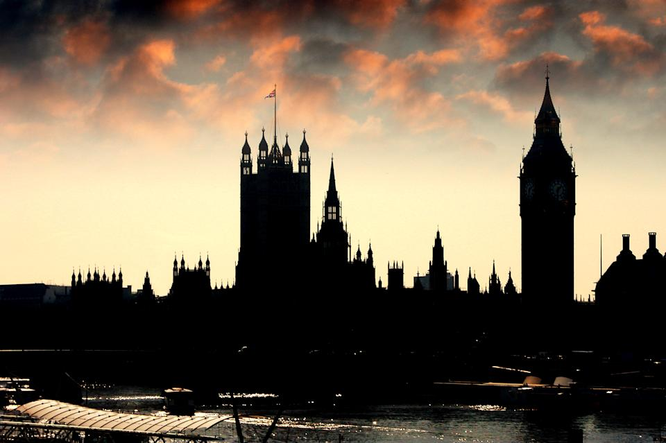 Silhouette of the Houses of Parliament at dusk.