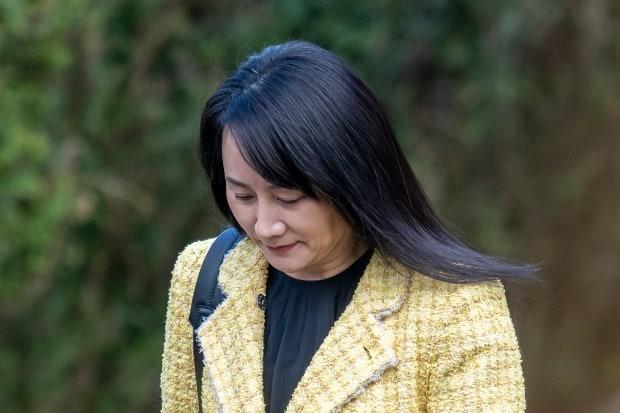 Huawei chief financial officer Meng Wanzhou heads to B.C. Supreme Court where she is fighting extradition to the United States on fraud and conspiracy charges. (THE CANADIAN PRESS/Jonathan Hayward - image credit)