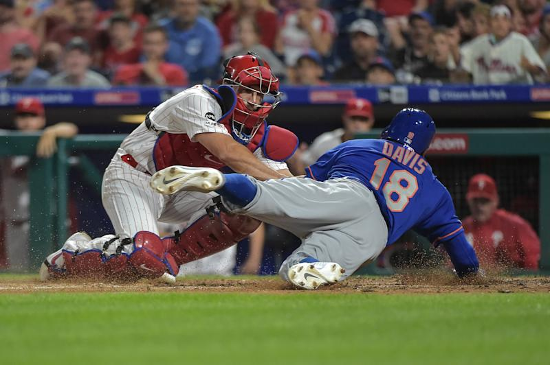 Sep 1, 2019; Philadelphia, PA, USA; Philadelphia Phillies catcher J.T. Realmuto (10) tags out New York Mets center fielder Rajai Davis (18) at the plate during the eighth inning of the game at Citizens Bank Park. Mandatory Credit: John Geliebter-USA TODAY Sports