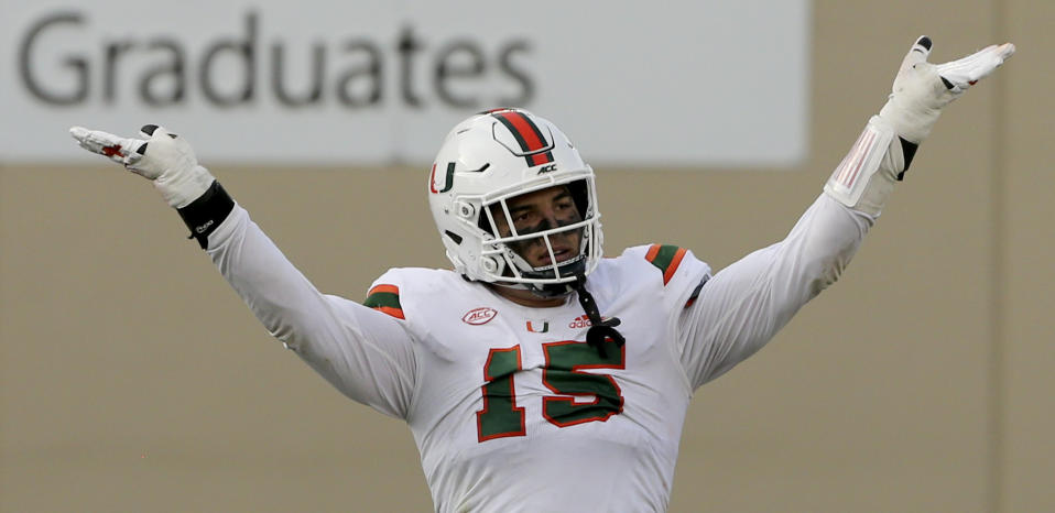 Jaelan Phillips of Miami celebrates a defensive stop against Virginia Tech. (Matt Gentry/The Roanoke Times via AP, Pool)