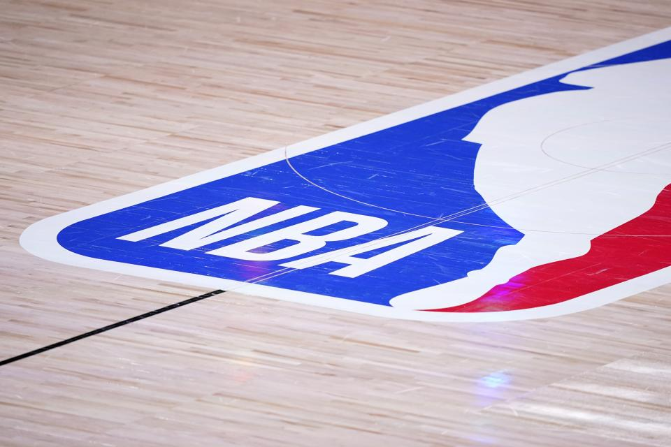 The court floor and league logo are shown after Game 3 of the NBA basketball Western Conference final between the Los Angeles Lakers and Denver Nuggets on Tuesday, Sept. 22, 2020, in Lake Buena Vista, Fla. (AP Photo/Mark J. Terrill)
