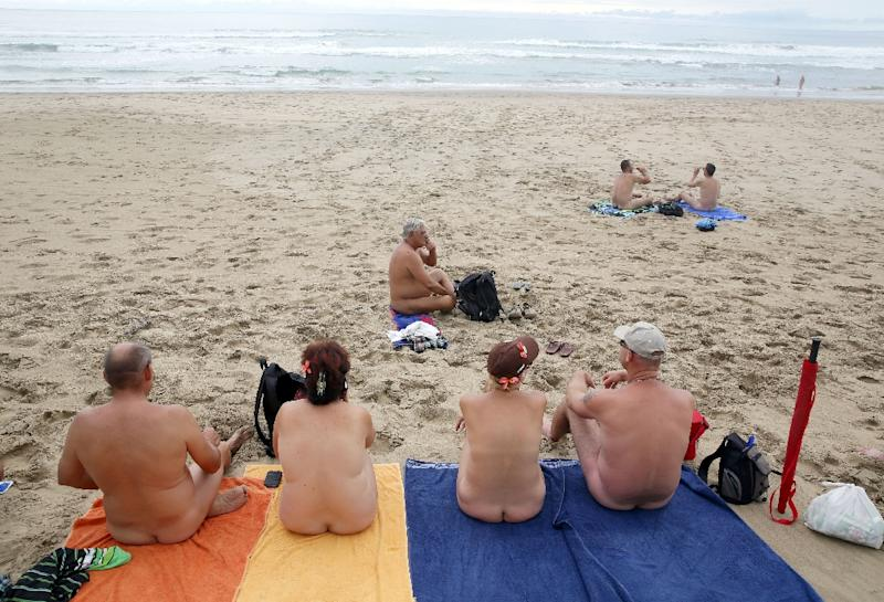 Naturists relax during the Easter weekend at the Mpenjati beach in South Africa on April 04, 2015