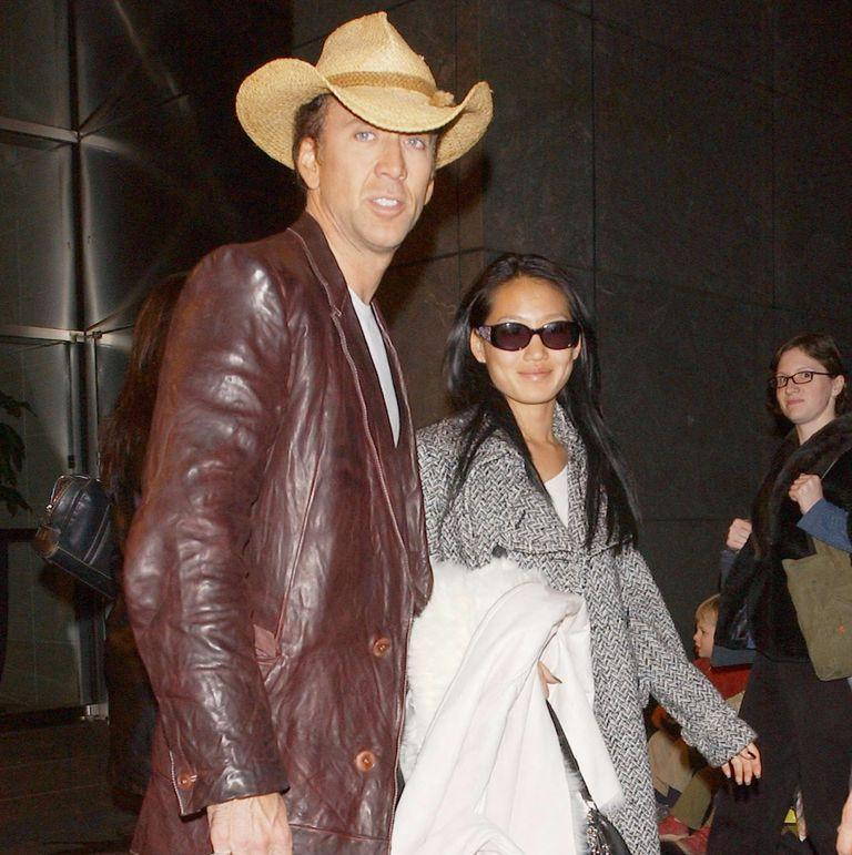 <p>Wow. Nicolas Cage and his wife, Alice Kim, leave a midtown hotel for the airport on November 19, 2004 in New York City. </p>