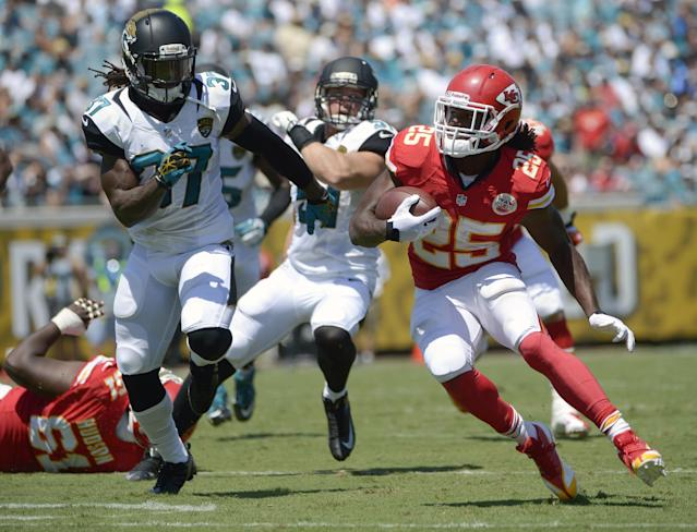 Kansas City Chiefs running back Jamaal Charles (25) looks for a way past Jacksonville Jaguars free safety John Cyprien (37) during the first half of an NFL football game in Jacksonville, Fla., Sunday, Sept. 8, 2013.(AP Photo/Phelan M. Ebenhack)