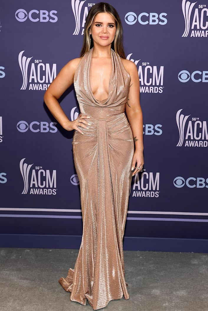 "<p>takes the plunge in a draped LBV halter gown, which she told PEOPLE she had picked out since the Grammys.</p> <p>""That was probably the earliest I've ever just put a dress on and been like, 'This fits me like a glove. Save this for the ACMs in a few months because I know I'm going to be obsessed with it then,"" the night's winner told PEOPLE ahead of the show. </p>"