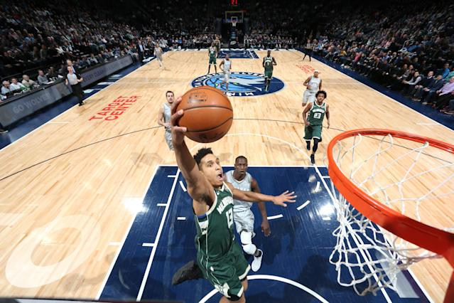 Malcolm Brogdon rises up for a finish early in the second quarter against the Timberwolves. He'd leave after this play. (Getty)