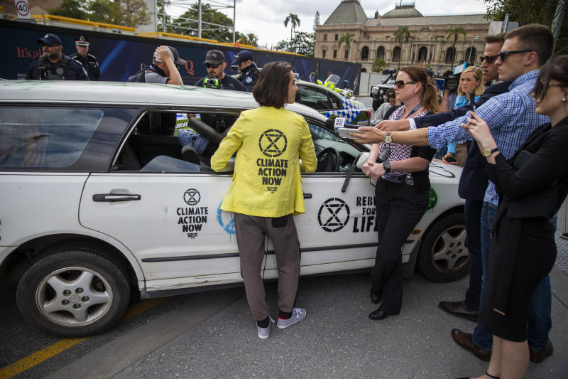 "Extinction Rebellion activist Eric Herbert is seen participating in a protest outside 1 Williams Street, Brisbane, Thursday, October 10, 2019. The Extinction Rebellion climate protests movement has planned a ""spring rebellion"" from Monday to Sunday, including marches aimed at blocking traffic."