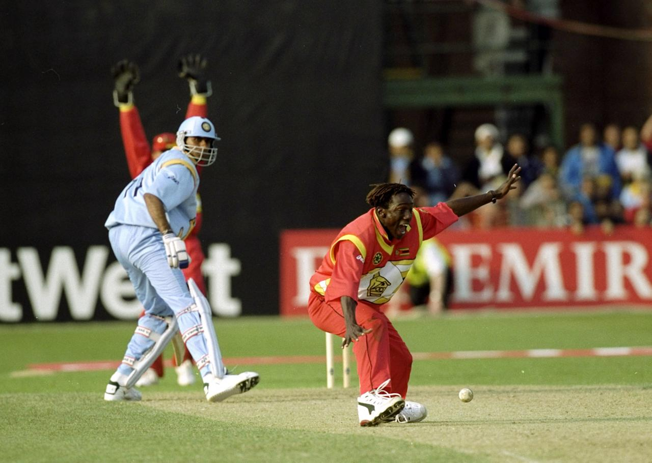 19 May 1999:  Henry Olonga of Zimbabwe traps Venkatesh Prasad of India and Zimbabwe beat India in the Cricket World Cup Group A match played in Leicester, England. Zimbabwe won the game by 3 runs. \ Mandatory Credit: Mike Hewitt /Allsport