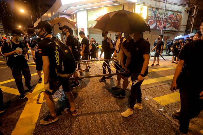 Protesters build barricades near the Chinese Liaison Office (AFP/Getty Images)