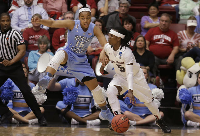 South Carolina guard Khadijah Sessions (5) drives against North Carolina guard Allisha Gray (15) during the first half of a regional semifinal game at the NCAA college basketball tournament in Stanford, Calif., Sunday, March 30, 2014. (AP Photo/Jeff Chiu)