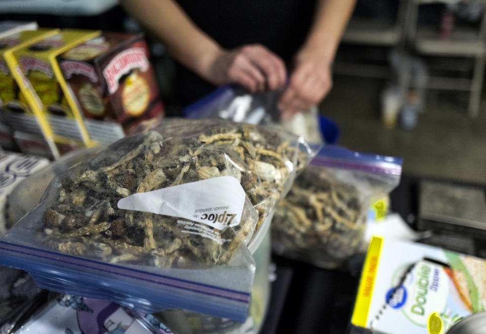 "A vendor bags psilocybin mushrooms at a pop-up cannabis market in Los Angeles on Monday, May 6, 2019. Voters decide this week whether Denver will become the first U.S. city to decriminalize the use of psilocybin, the psychedelic substance in ""magic mushrooms."" (AP Photo/Richard Vogel)"