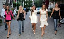 <p>Victoria Beckham led a gaggle of WAGs on a night out during the 2006 World Cup decked in hot pants and a fuschia-hued top. Colleen McLoughlin (the then-girlfriend of Wayne Rooney), Louise Owen (wife of Michael Owen) and Elen Rivas (fiancé of Frank Lampard) joined the former Spice Girl in peep-toe heels and co-ordinating blow drys. <em>[Photo: Rex]</em> </p>