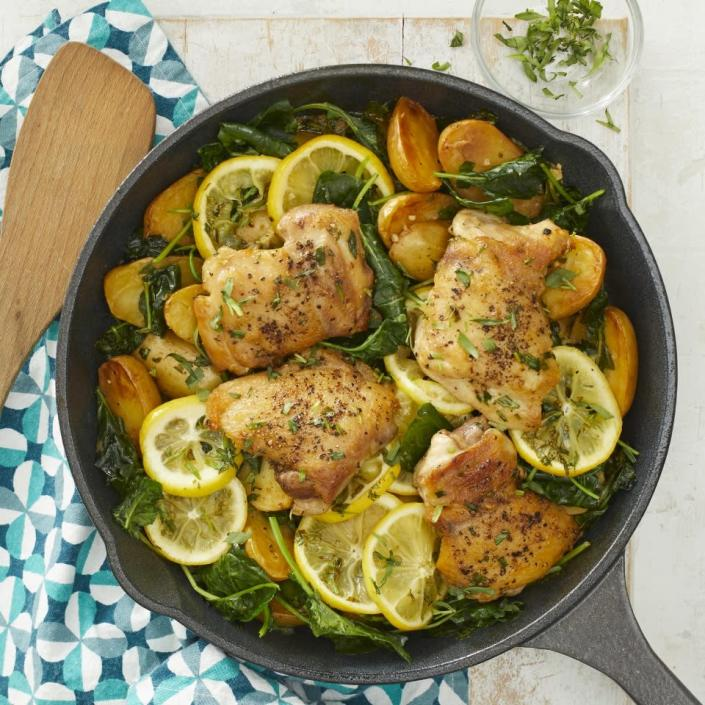 """<p>This easy one-pan skillet-roasted lemon chicken is perfect for weeknight dinners. Juicy chicken thighs are cooked in the same pan as baby potatoes and kale for a satisfying meal with the added bonus of minimal cleanup. <a href=""""https://www.eatingwell.com/recipe/272467/skillet-lemon-chicken-potatoes-with-kale/"""" rel=""""nofollow noopener"""" target=""""_blank"""" data-ylk=""""slk:View Recipe"""" class=""""link rapid-noclick-resp"""">View Recipe</a></p>"""