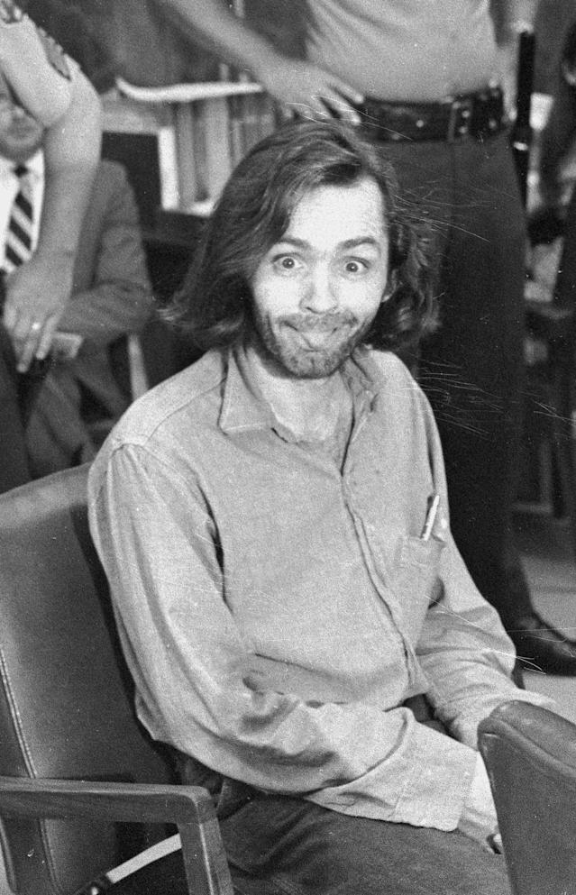 <p>Charles Manson mugs for the camera in the courtroom during his trial in Independence, Calif., on June 25, 1970. (Photo: AP) </p>