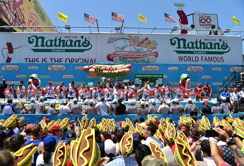 """Nathan's July 4th hot dog eating contest. Thursday, July 4th 2019 The 103rd annual Nathan's July 4th Hot Dog eating contest in Coney Island Brooklyn, NYC on Stilwell & Surf avenues. Joey """"Jaws"""" Chestnut, the defending men champion won with 71 hot dogs and buns in 10 minutes while the women contest was also won by the defending champion Miki Sudo with 31 hot dogs and buns."""