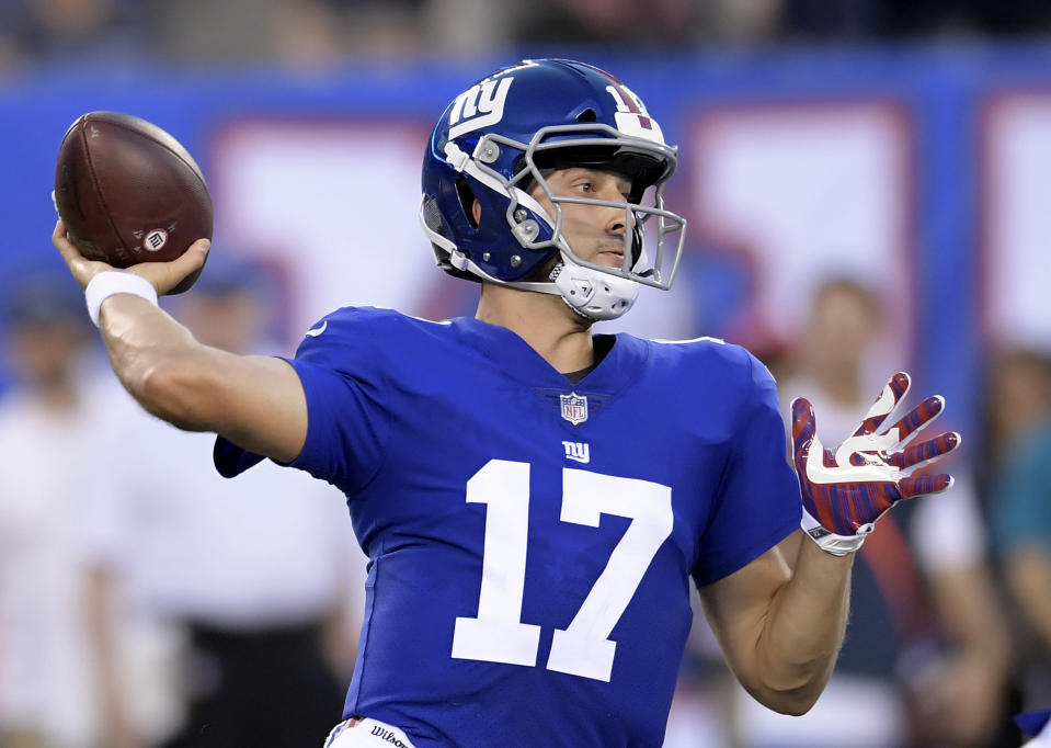 New York Giants quarterback Kyle Lauletta throws a pass against the New England Patriots during the first half of an NFL football game, Thursday, Aug. 30, 2018, in East Rutherford. (AP Photo/Bill Kostroun)