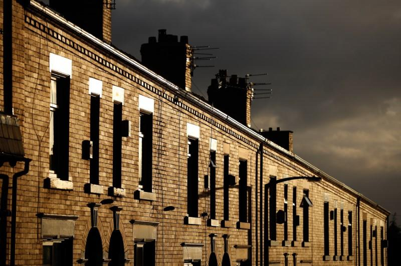 A row of terraced houses glows in the afternoon sunshine in Oldham